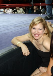 Raising money at Lou Neglia's Friday Night Fights by being a middle aged ring girl.